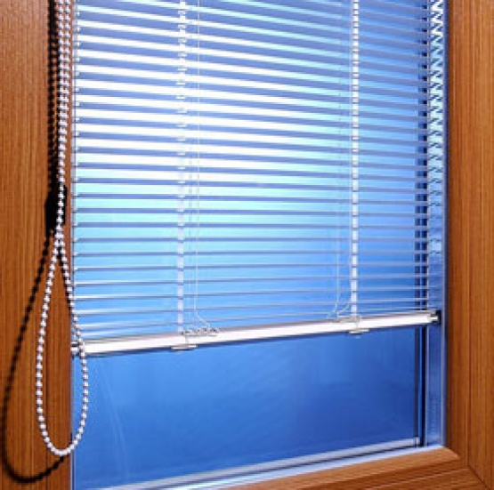 Integral blinds inside hermetically sealed glass